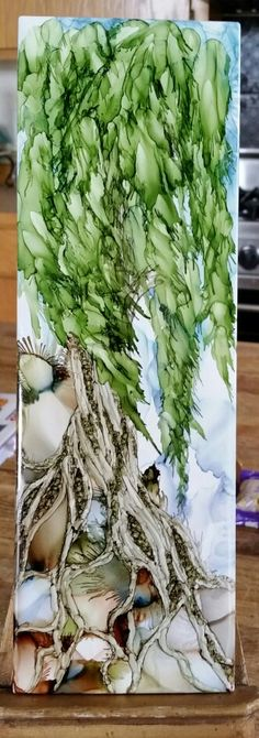 Tree in alcohol ink on 12x4 tile by Tina. By Tina