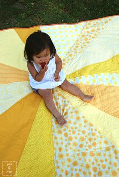 This looks fun. It's meant to be a picnic blanket and is built to serve that purpose, but it's exactly the kind of giant sunburst pattern I've been thinking about! | Tutorial: Sunburst Picnic Blanket | you and mie
