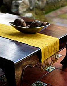 Guadalupe Sam weaves an exquisite #table runner in bright yellow cotton. Tracing paths along the textile are Guatemala's traditional jaspe motifs in green, black and white.