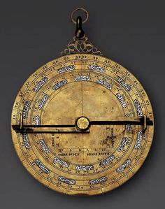 Silver-inlaid brass planispheric astrolabe Spain, probably Toledo, 14th century. Engraved copper alloy inlaid with silver