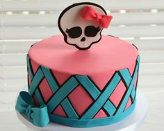 Monster High Birthday - Monsters High Birthday Cake.  My cousin is allergic to tree nuts.  For her birthday, I created a special white cake with buttercream frosting.  It is covered with a mix of Pettinice & Fondarific fondants.  The skull logo was created with a mix of gumpaste & fondant.