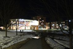 The snow has fallen on campus at Skidmore College in Saratoga Springs, NY. The Dining Hall's large windows shine a bright light on the winter scene.