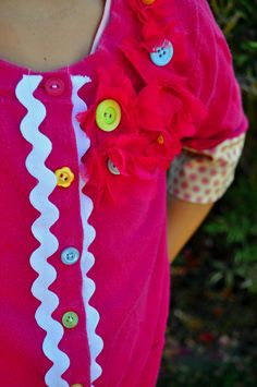 Upcycle a child's shirt with buttons and trim.