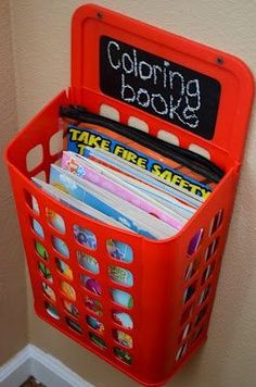 IKEA garbage bin (with cute chalkboard label added) to hold books along with lots of other great play room organizing ideas.