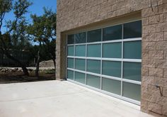 Contemporary Glass/Aluminun Garage Doors. Hill Country Garage Doors. Spicewood. TX. (Click on photo for slightly larger image.) Photo found here: http://www.hillcountrydoors.com/glassgaragedoor.html