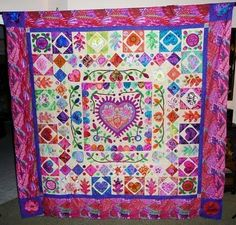 Glorious Applique: Kim McLean Hearts and Flowers Quilt- I love all the color! I actually picked up a batik that has these colors today.