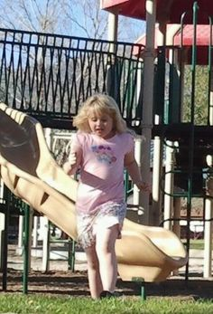 Rylie running at the playground.  7 yrs old