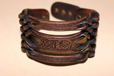 Exclusive leather bracelet with a runic spell on Profit. Skin thickness 4 mm. Bracelet width 4.5 cm (1.77) Designed for wrist 16.5-19.5 cm (6.5 - 7,68) Spell for a profit. Formula for Business profit and increase ownership. Combination runes: • OTAL (Otila) - Rune of inheritance