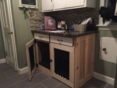 Custom built in dog kennel done in existing cabinets