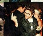 Michael hutchence  angry with the paparazzi.