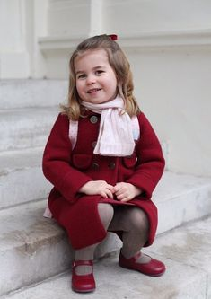 The two-year-old Princess Charlotte of Cambridge was pictured ahead of her big first day at nursery, carrying a cute backpack by Cath Kidston and wearing this very smart Amaia Kids Razorbil double breasted buttons red coat with pocket details, teamed with a pink scarf and red shoes.