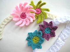 A few free crochet patterns. Small booties, flower and little girl motif, scarf, crochet needle case, purse for little girl, belt, easter bunny basket, recycled bag handle, Halloween witch basket