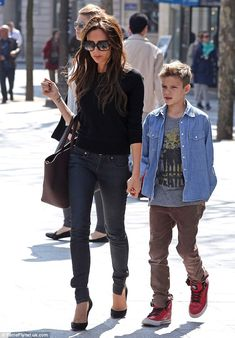 Model behaviour: Romeo held on tightly to his mothers hand as he got some alone time with her