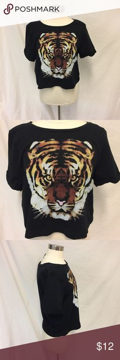 Divided Sweatshirt with Tiger So cute! I wish this fit me because I would wear it with some cute black skinnier and some moto booties or a skater skirt, some booties, and a gray faux leather jacket. 100% cotton Divided Tops