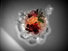 Miniature flowers made from pantyhose, wire and nail polish. B&W with colour spot. Nelson, New Zealand