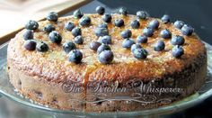"<p><span style=""color: #222222; font-family: arial, sans-serif; font-size: small;"">A moist and tender cake. The amazing flavors are clean and bright. A perfect dessert for a Sunday brunch with your friends sipping a cup of tea. Recipe from <a title=""The Kitchen Whisperer"" href=""http://www.thekitchenwhisperer.net/2013/08/02/blueberry-lemon-coconut-sunburst-coffeecake-with-lemon-glaze/"" target=""_blank"">The Kitchen Whisperer</a></span></p>"