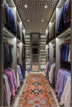 Courtney Elias in Houston. For a man who clearly loves his clothes!  Notice the ceiling.  Again, the closet was designed taking into account every detail.