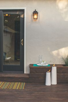 Minka-Lavery Irvington Manor Outdoor Wall Sconce and Chilewich Striped Indoor/Outdoor Mat