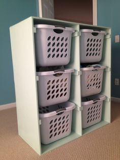 We made this shelf to organize our laundry baskets!