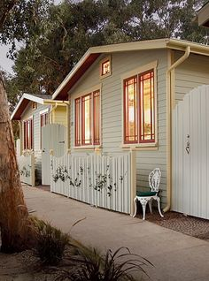 fence design. Venice Beach eco cottages, red and light aqua paint combo