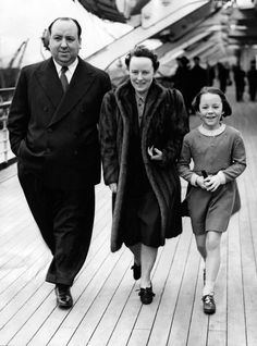 British film director Alfred Hitchcock walks with his wife Alma Reville and their daughter Pat Hitchcock aboard the Queen Mary at Southampton, Great Britain, before departure to America, on March 04, 1939. In United States he is to become Britain's most successful film export since Charlie Chaplin.