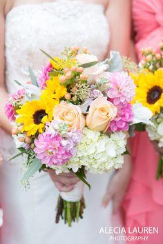 Bright Spring!  A lovely mix of sunflowers, dahlias, hydrangea, roses, hypericum, seeded eucalyptus and stock.