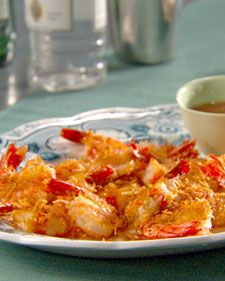 "Lightly fried coconut shrimp is served with a spicy-sweet dipping sauce for a fun and easy party appetizer.    From the book ""Lucinda's Authentic Jamaican Kitchen,"" by Lucinda Scala Quinn (Wiley)."