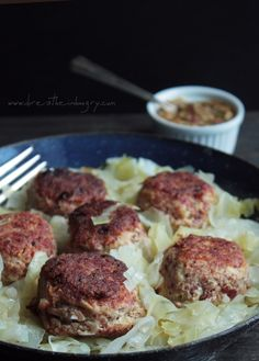 Corned Beef Meatballs with Cabbage, Low Carb and Gluten Free - You can serve the meatballs a la carte with mustard (they make a great appetizer) or you can turn it into a complete meal by serving it alongside the cooked cabbage. Each serving of 3 meatballs, 1.8g net carbs - Per serving of meatballs and cabbage, 4g net carbs