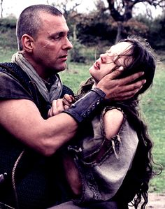 """""""Cecellia? Cecelia!!"""" Theoden's rough hand cradles the fragile face of the warrior princess. Her own hands despreratly clawing for a hold, while her legs give way beneath her. In one swift motion she lies in his arms, eyes fluttering, than finally closing. As they both begin to be covered in an gory layer of blood Kipling realises how tragic their situation could be. How long had she been hiding her wound? How much longer could he keep her breathing?"""