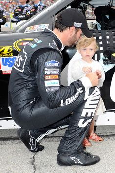 Jimmie Johnson, driver of the #48 Lowe's/Kobalt Tools Chevrolet, with daughter Genevieve Marie before the NASCAR Sprint Cup Series Samsung Mobile 500 at Texas Motor Speedway on April 14, 2012 in Fort Worth, Texas.
