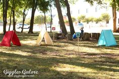 Camping Party A Frame Tents. Build a simple frame with 1×2 boards and wooden dowels and staple fabric to them in the party colors.