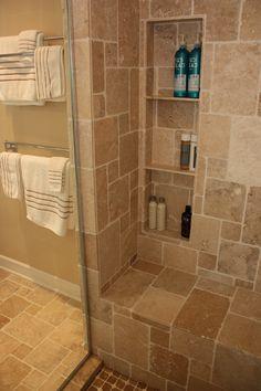 Bathroom design by Matthew Krier of Design Group Three. Travertine tile, Granite tops, rain shower head, tiled bench and niches.