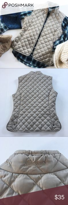 "Eddie Bauer Quilted Goose Down Vest Size Small From my personal closet, this Eddie Bauer Quilted Goose Down Vest is an awesome piece. Slenderizing fit and warmth without bulk. Cute with a t-neck or flannel, jeans and boots or layer under a jacket for extra warmth. Zip closure. Khaki.   Details: * Size Small * Shell and lining 100% polyester  * Insulation: Goose Down * Machine wash and dry per tag instructions or dry clean * EUC  * Smoke free pet free  Measurements taken flat ▫️Waist: 15.5""…"