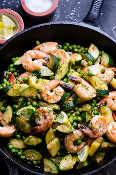Sautéed in butter shrimp, crunchy zucchini and bursting peas with lemon juice and zest, garlic and dill. 15 minutes summer quick dinner.