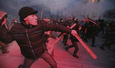 Protesters clash with police in Kiev, Ukraine, on Sunday. Protesters clash with police in Kiev, Ukraine, on Sunday. Photograph: Kommersant ...