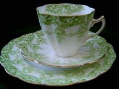 Similar to a cup and saucer I bought in a London street market - a little bit of English elegance for a side table.