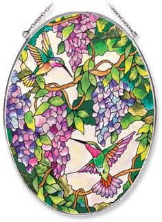 Amia Oval Suncatcher with Hummingbird and Wisteria Design, Hand Painted Glass, 6-1/2-Inch by 9-Inch by Amia. $24.00. Handpainted glass. Comes boxed, makes for a great gift. Includes chain. Amia glass is a top selling line of handpainted glass decor. Known for tying in rich colors and excellent designs, Amia has a full line of handpainted glass pieces to satisfy your decor needs. Items in the line range from suncatchers, window decor panels, vases, votives and much more.