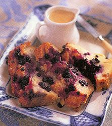 Huckleberry Bread Pudding with Maple Custard Sauce_Recipe for Mark Miller's Huckleberry Bread Pudding. Accompany this decadent bread pudding with the maple custard sauce or just dust with powered sugar.