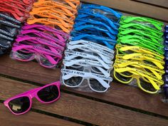 A little bit of every color! This large order of personalized sunglasses were made for an engagement party. Congratulations Danielle and Kevin! Personalized Sunglasses, Custom Sunglasses, Bachelorette Sunglasses, Wedding Sunglasses, Bach Bash, Bachelorette Gift, Wayfarer Sunglasses