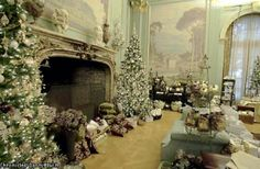 A ballroom fireplace is decorated with Christmas trees at the Filoli House in Woodside.