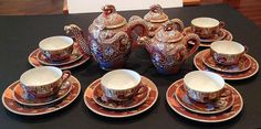 Vintage Satsuma Dragon Ware Tea Set Lithophane Geisha - Service for 6      It has lithophane geishas in the cups. This is a set for six, with