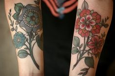 Colorful flower mandala tattoos, by Alice Carrier, I think.