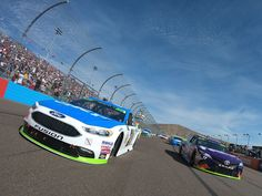 Ryan Blaney Photos - Ryan Blaney, driver of the #21 SKF/Quick Lane Tire & Auto Center Ford, and Denny Hamlin, driver of the #11 FedEx Ground Toyota,  lead the field at the start of  the Monster Energy NASCAR Cup Series Can-Am 500 at Phoenix International Raceway on November 12, 2017 in Avondale, Arizona. - Monster Energy NASCAR Cup Series Can-Am 500