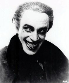 """Gwynplaine (Conrad Veidt ) from """"The Man Who Laughs"""" (1928), A film based on the novel by Victor Hugo.  Gwynplaine's lanky physique and grotesque grin was the visual inspiration for Batman's archenemy, The Joker."""