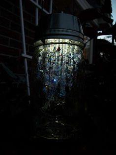 Solar mason jar how-to with beaded chandelier inside. Pretty!