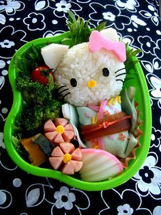 Hello Kitty Bento in Japanese tradition clothing and hot dogs cut as flowers.