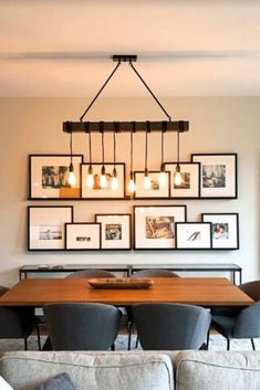 This dining room features a gorgeous dinner table, and a fabulous light fixture. But, what transformed the space the most was the gallery wall! We hope this gives you some ideas for your gallery wall layout! Dining Room Feature Wall, Dining Room Art, Dining Room Lighting, Dining Room Design, Living Room Decor, Dining Wall Decor Ideas, Dining Room Decorating, Living Room Gallery Wall, Dinning Room Light Fixture