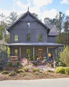 BECKI OWENS--Colors of the Modern Farmhouse + Paint Guide. Beautiful black Farmhouse exterior.