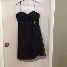 Perfect little black dress This is the perfect little black dress! Worn only once and in great condition, freshly dry-cleaned, polyester with a beautiful beaded accent. Price negotiable! Dresses