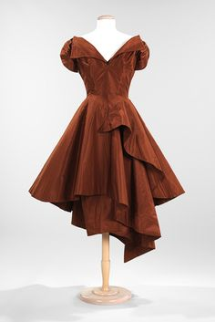 Cocktail dress, 1952  Charles James (American, born Great Britain, 1906–1978)  Tobacco brown silk taffeta, brown jersey